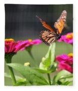 Monarch Approaching Zinnia Fleece Blanket