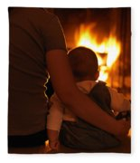 Mother And Son Sitting In Front Of A Firepalce Fleece Blanket
