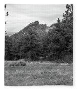 Mountain Peak Through The Trees In Black And White Fleece Blanket