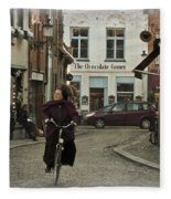 Nun On A Bicycle In Bruges Fleece Blanket