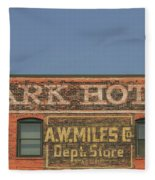 Old Faded Advertisement On An Old Brick Building Fleece Blanket