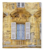 Old Yellow Building With Lace Curtain In Nice, France Fleece Blanket
