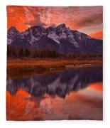 Orange Skies Over The Tetons Fleece Blanket