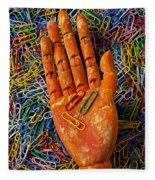 Orange Wooden Hand Holding Paperclips Fleece Blanket
