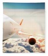 Passenger Airplane Flying At Sunshine, Blue Sky. Fleece Blanket
