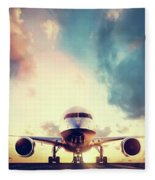 Passenger Airplane Taking Off On Runway At Sunset Fleece Blanket