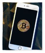 Phone With A Bitcoin Laying On Top Of It. Fleece Blanket