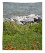 Pile Of Rocks On Shoreline Fleece Blanket