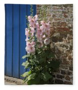 Pink Hollyhocks Growing From A Crack In The Pavement Fleece Blanket