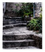 Plants Grow In The Uneven Stairs Climbing Towards The Tower Fleece Blanket