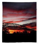 Red Skies At Pleasure Island Bridge Fleece Blanket