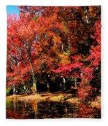 Red Trees By Lake Fleece Blanket