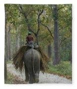 Riding An Elephant Fleece Blanket