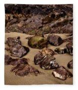 Rocks On The Beach Fleece Blanket