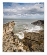Sea Meets Rocks At Howick Fleece Blanket