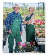 Senior Gardener And Middle-aged Gardener At Work. Fleece Blanket