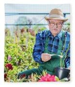 Senior Gardener Selecting A Tree. Fleece Blanket