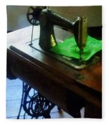 Sewing Machine With Green Cloth Fleece Blanket