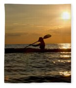 Silhouette Of Woman Kayaking In The Ocean. Fleece Blanket