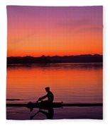 Silhouetted Man Rowing Fleece Blanket