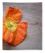 Single Poppy On Wood Fleece Blanket