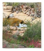 Slide Rock With Pink Wildflowers Fleece Blanket