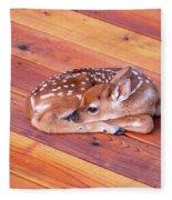 Small Deer Fawn Resting On Cedar Wood Deck Fleece Blanket