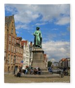 Statue Of Jan Van Eyck Beside The Spieglerei Canal In Bruges Fleece Blanket