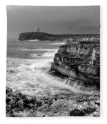 stormy sea - Slow waves in a rocky coast black and white photo by pedro cardona Fleece Blanket