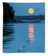Swans Gliding Into The Moonlight During A Moonrise In Stockholm Fleece Blanket