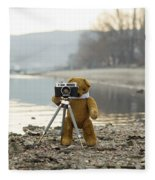 Teddy Bear Taking Pictures With An Old Camera By The Riverside Fleece Blanket
