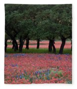 Texas Live Oaks Surrounded By A Field Of Indian Paintbrush And Bluebonnets Fleece Blanket