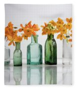 the Blooming yellow Ornithogalum Dubium in a transparent bottle instead vase Fleece Blanket