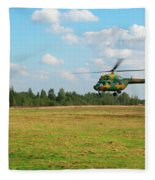 The Helicopter Over A Green Airfield. Fleece Blanket