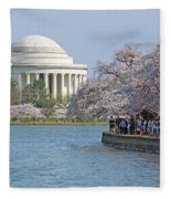 The Jefferson Memorial With Cherry Blossoms And A Lot Of People Fleece Blanket