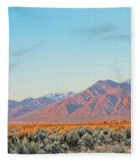 The Magic Light Of Taos  Fleece Blanket