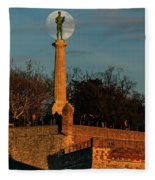The Moon Rising Behind The Victor Statue In Belgrade In The Golden Hour Fleece Blanket