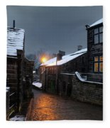The Village Of Heptonstall In The Snow At Night With Lamps Shini Fleece Blanket