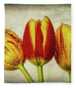 Three Dew Covered Tulips Fleece Blanket