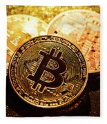 Three Golden Bitcoin Coins On Black Background. Fleece Blanket