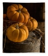 Three Pumpkins On A Bucket Fleece Blanket