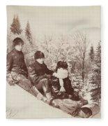 Three Tobogganers On A Snowy Hill Fleece Blanket