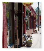 Thrift Shop And Sign In Manitou Springs Fleece Blanket