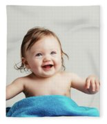 Toddler With A Cozy Blanket Sitting And Smiling. Fleece Blanket