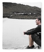 Tourist Seated At Dove Lake Lookout In Tasmania Fleece Blanket