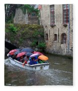 Tourists With Umbrellas In A Sightseeing Boat On The Canal In Bruges Fleece Blanket