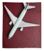 Toy Airplane Over Red Book Cover Fleece Blanket