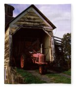Tractor Parked Inside Of A Round Barn Fleece Blanket