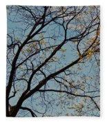 Tree Against The Sky Fleece Blanket