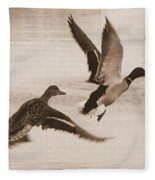 Two Winter Ducks In Flight Fleece Blanket